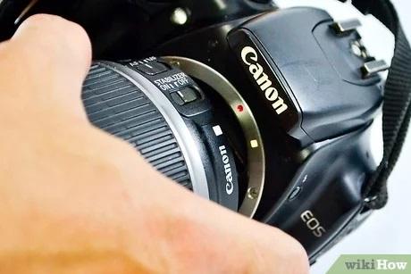 الأزرار والرموز على كاميرات كانون